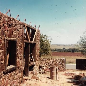 Photos that showcase the house under construction. All the stone used for building the house was collected in the area.